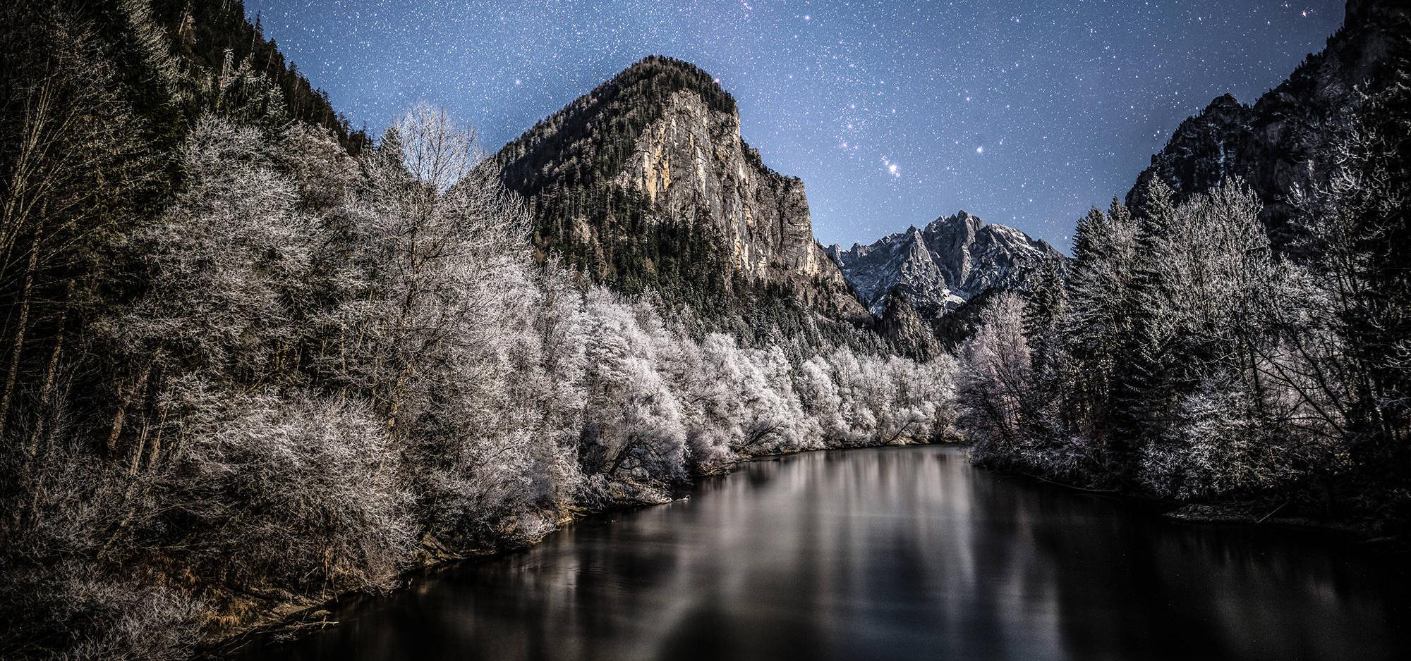 River and mountain at night